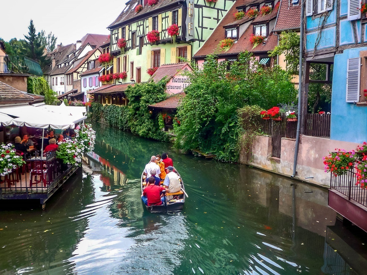 People taking a boat ride in the canal in Colmar