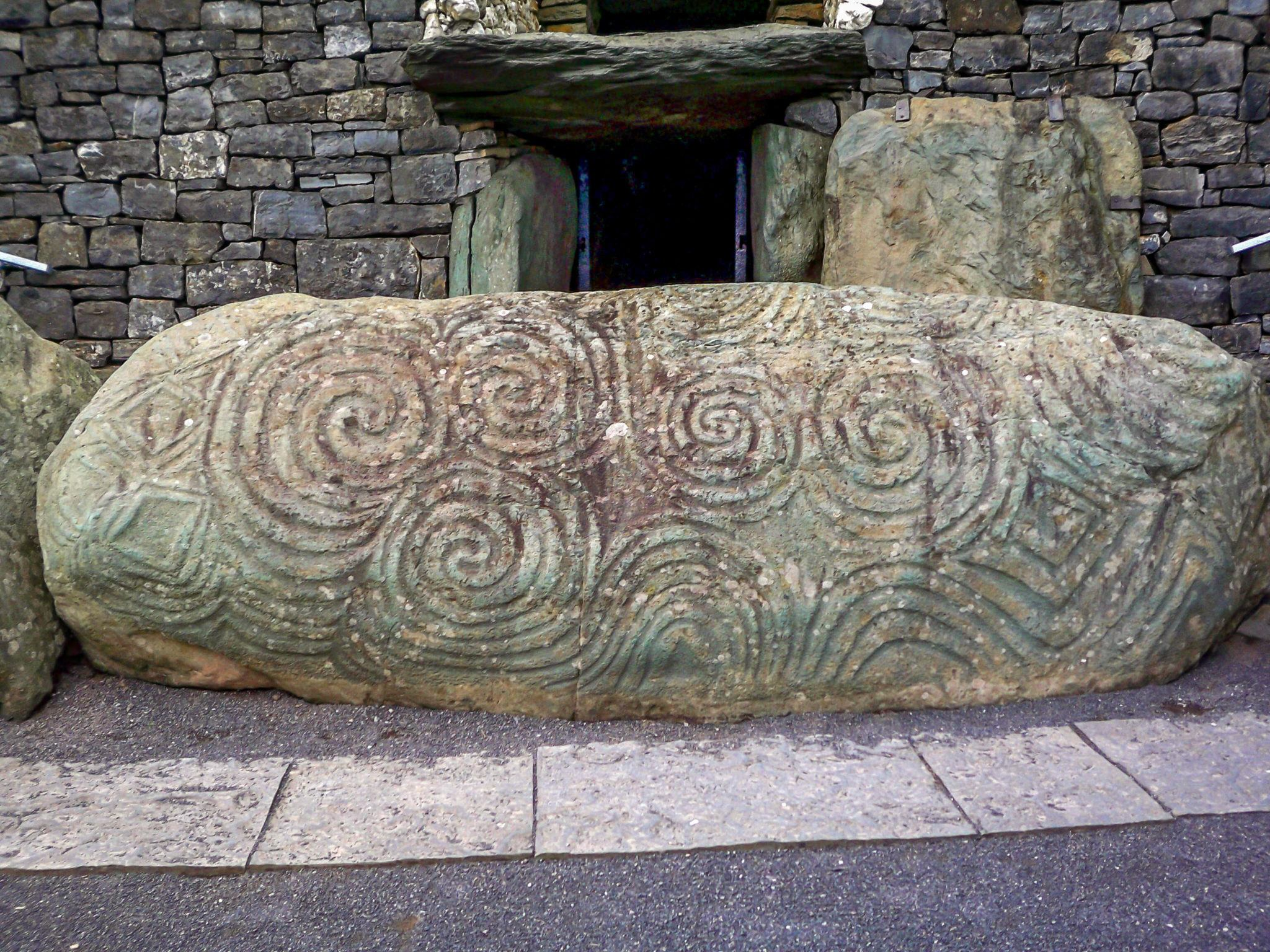 Carved Neolithic stone at the entrance of Newgrange passage tomb