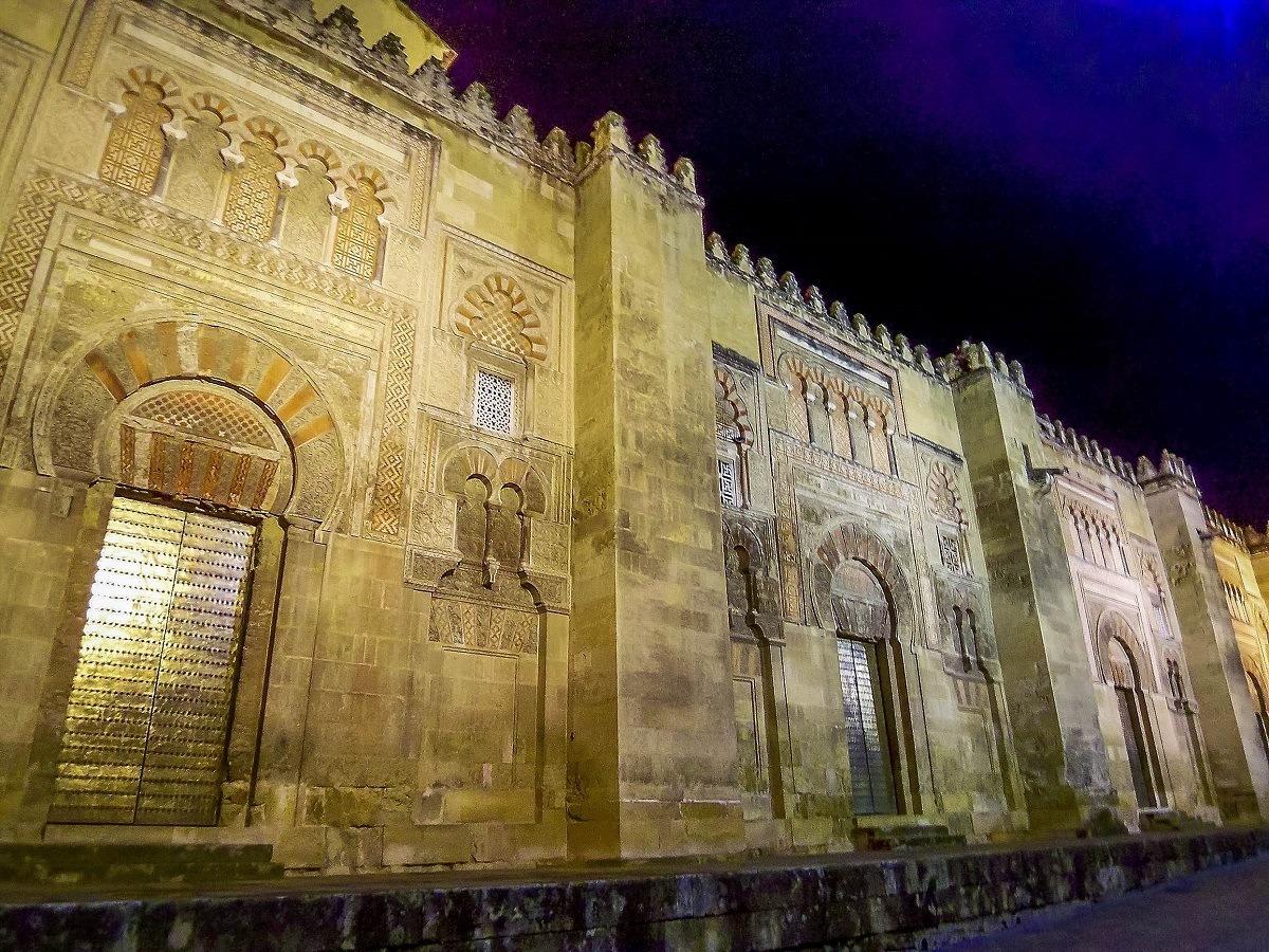 The facade of La Mezquita Cordoba at night
