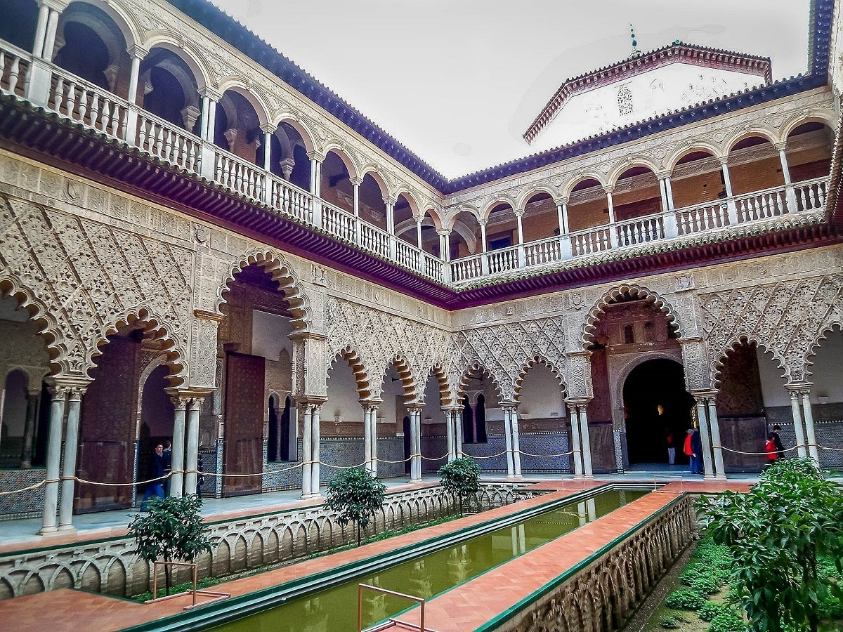 The courtyard of the Seville Alcazar palace in Spain