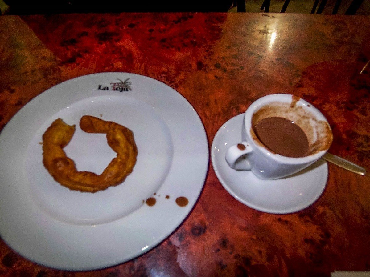 A snack of churros and chocolate