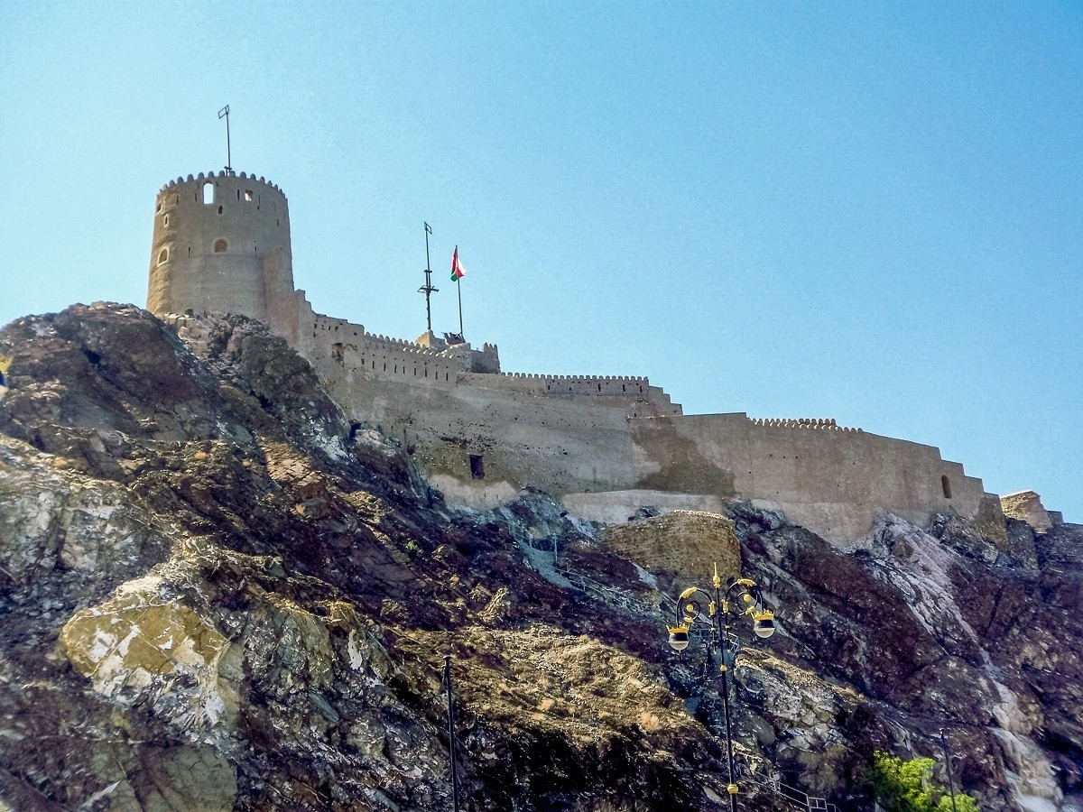 The Muttrah Fort towers above the harbor