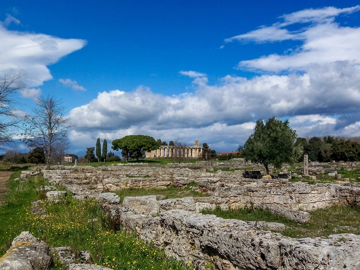 Stone ruins of the temple complex and the old Temple of Athena