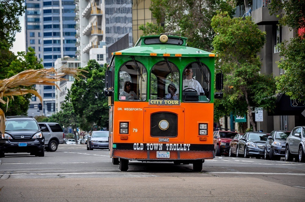 The green and orange Old Town Trolley