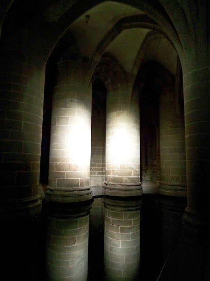Columns inside the Abbey, which is illuminated at night