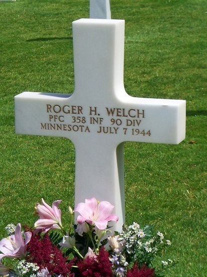 One of the white marble tombstones in the American Cemetery in Normandy