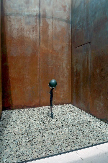 A metal sculpture in the American Cemetery