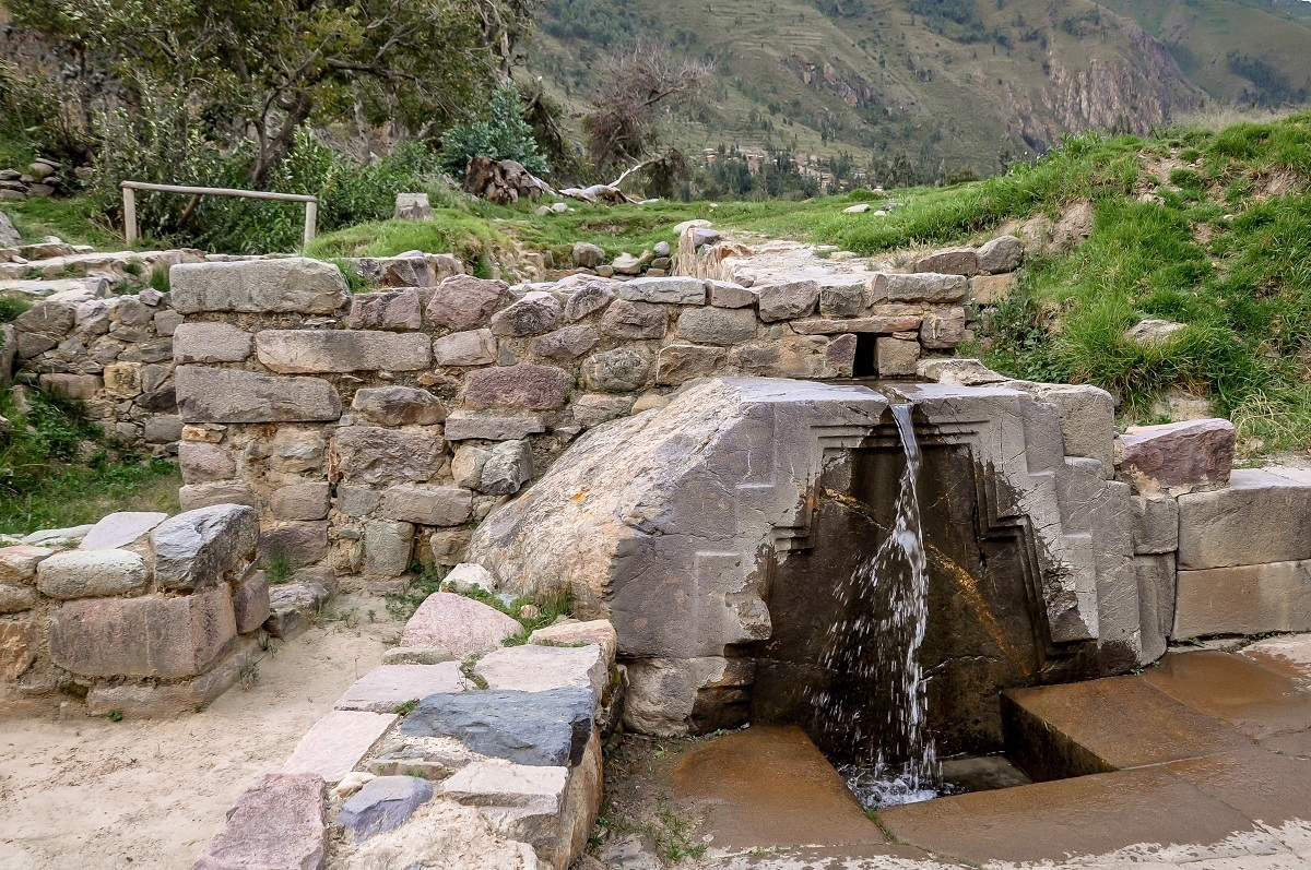Water pouring through the Bath of the Princess fountain at Ollantaytambo