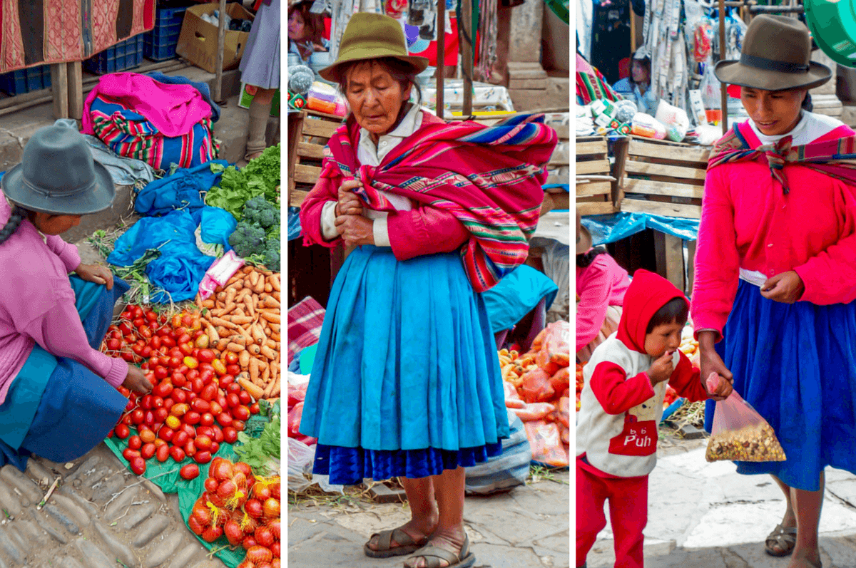 Women in traditional garb buying and selling at the Pisac market