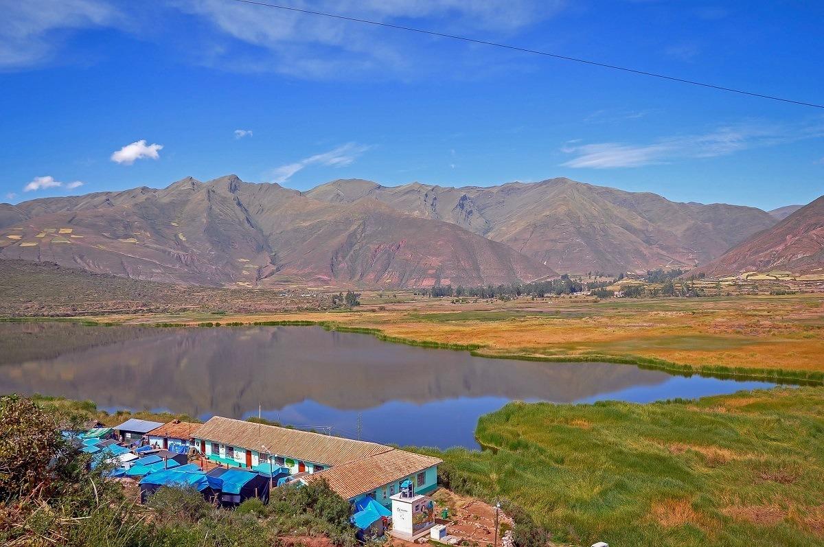 Tent camp on the edge of mountain lake outside Cusco