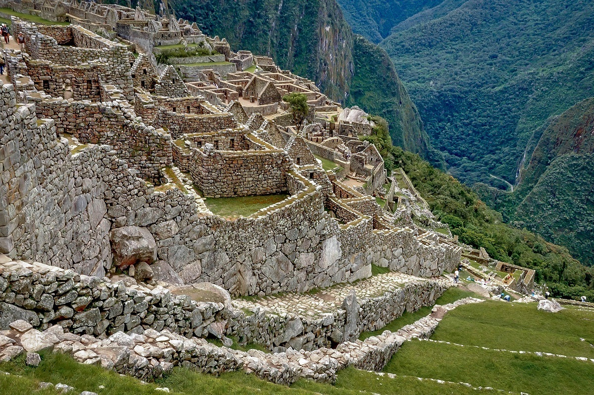 Steep staircase leading down to the ruins of houses at Machu Picchu