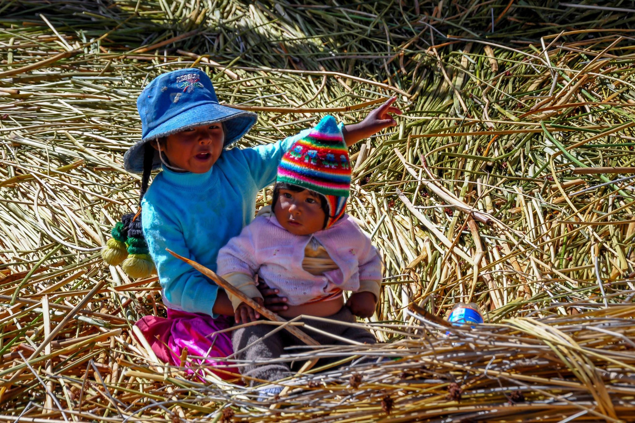 Two young children playing in Peru