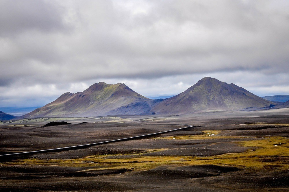 Barren volcanic rock landscape with two large hills