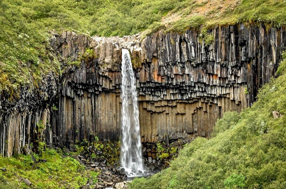 Hiking the waterfalls in Iceland, like Svartifoss