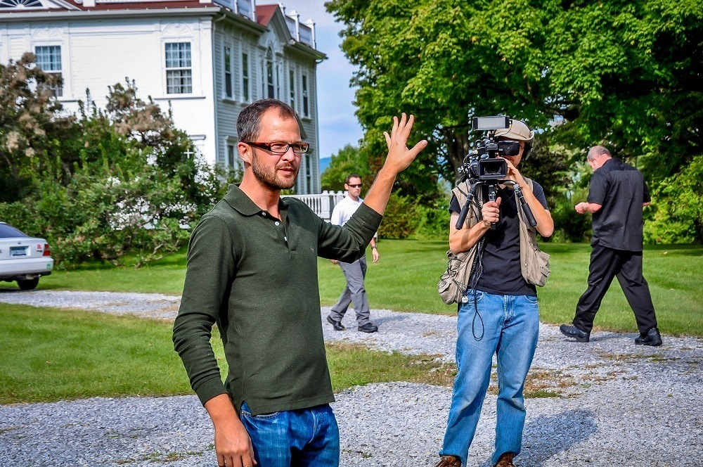 Man being filmed by a person with a TV camera