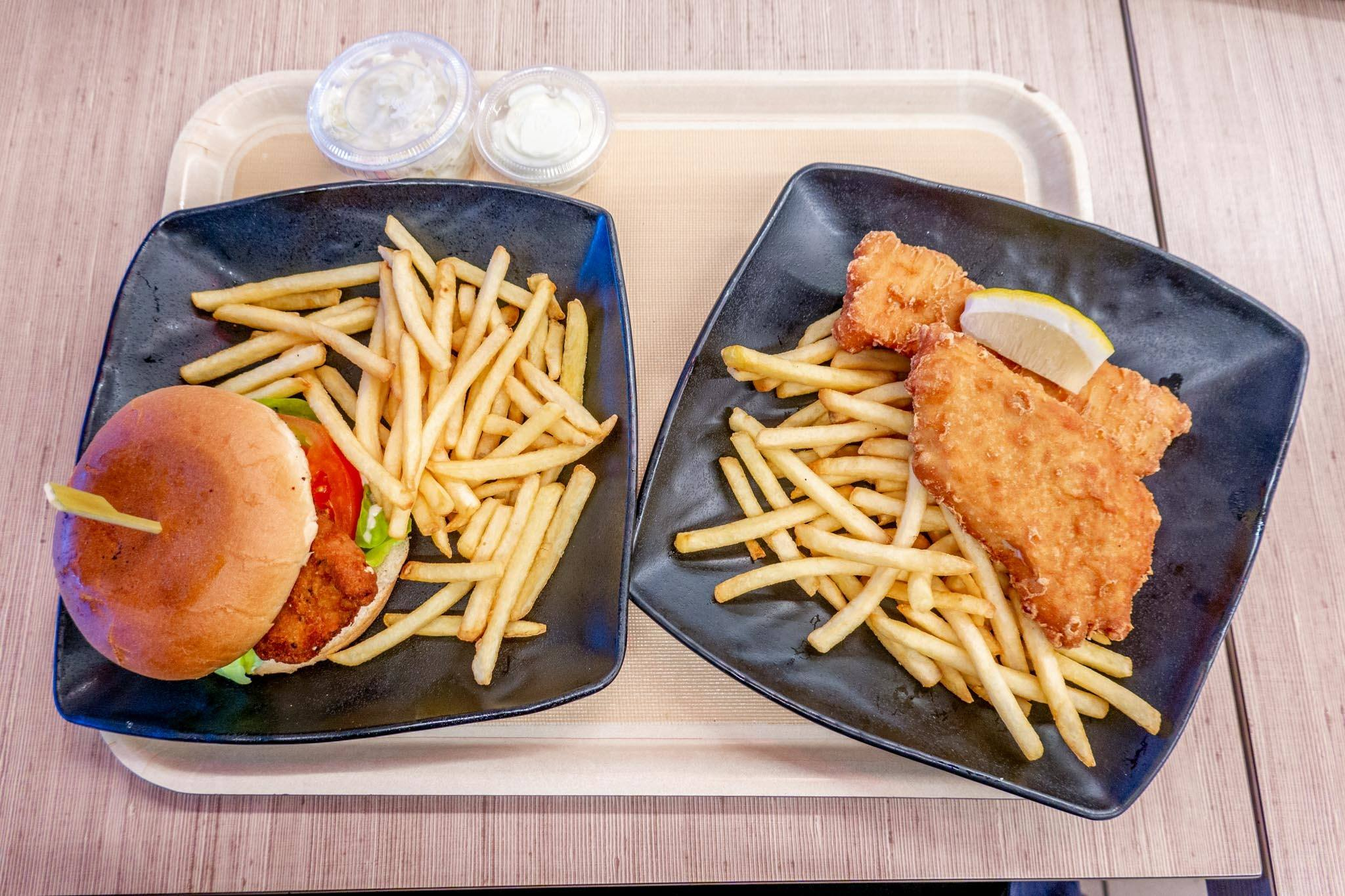 Plates of fish and chips and also a chicken sandwich