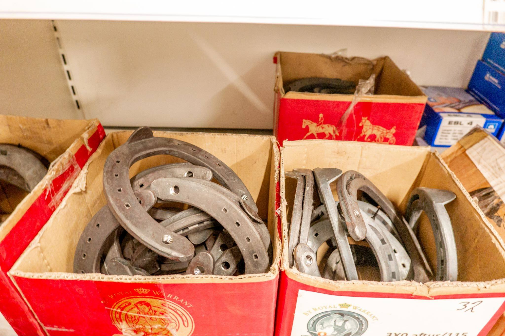 Boxes of horseshoes and farm supplies