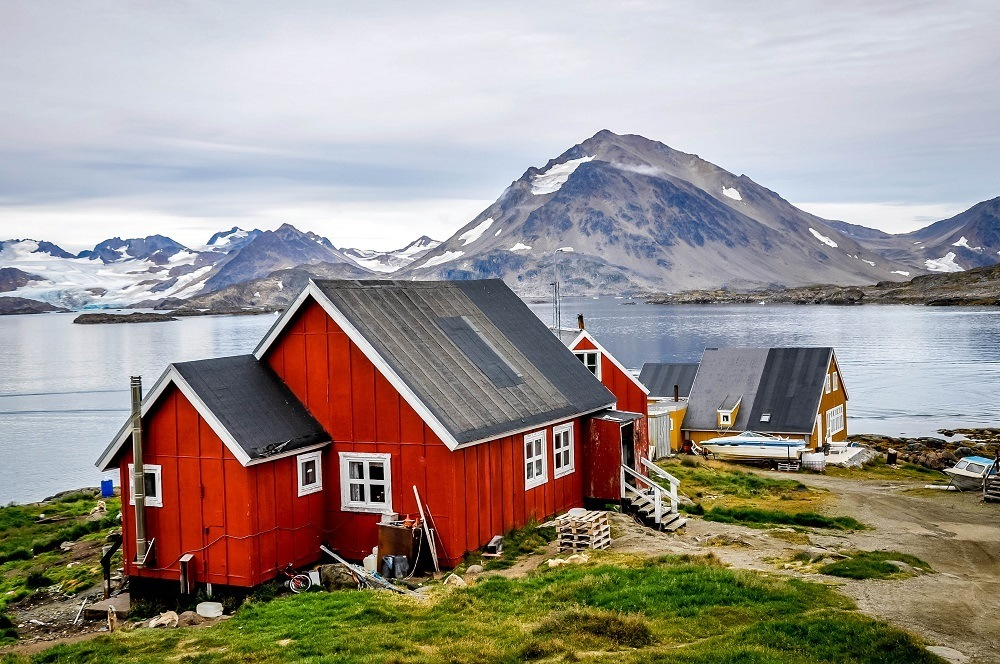 Bright red house near the ocean in Greenland