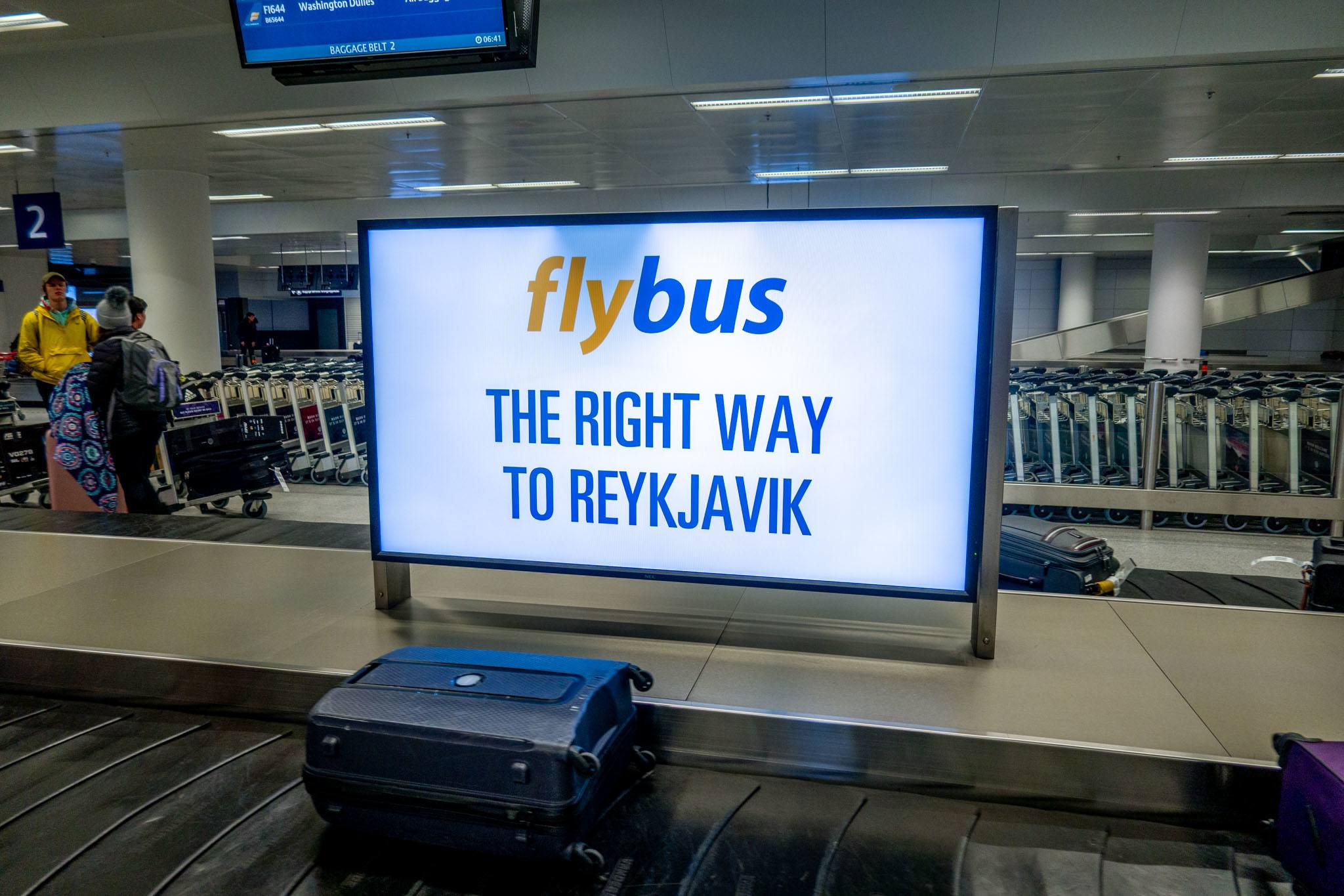 Reykjavik Excursions sign for the Flybus in the baggage claim area at Keflavik airport