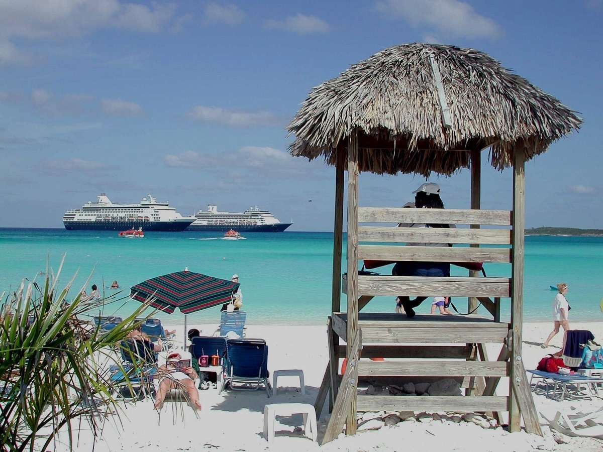 Two cruise ships off the shore of the company's private island