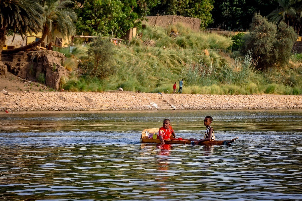 Boys in a homemade boat in the Nile River
