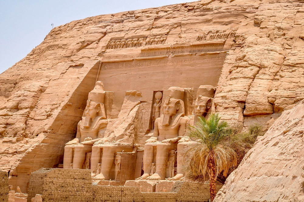 Front of Abu Simbel with palm tree