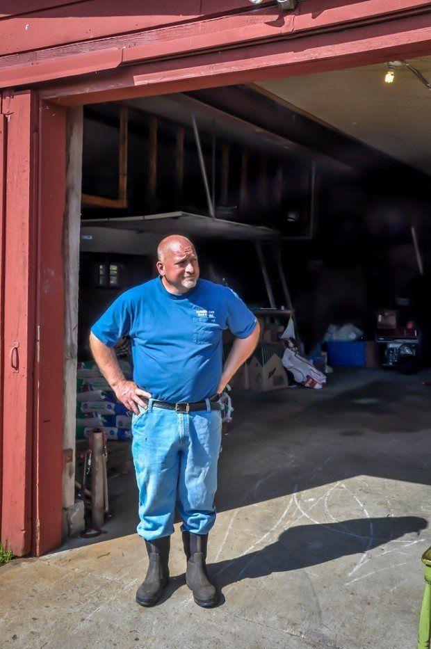 Man standing in the doorway of a barn