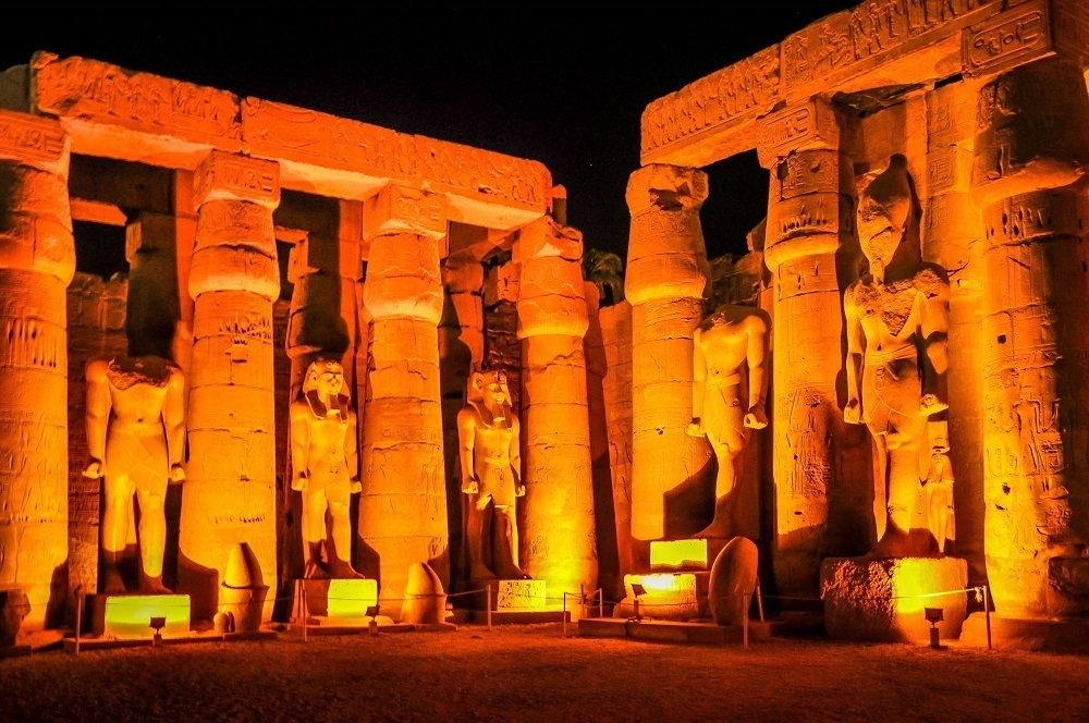 Pharaoh statues at the Temple of Luxor at night