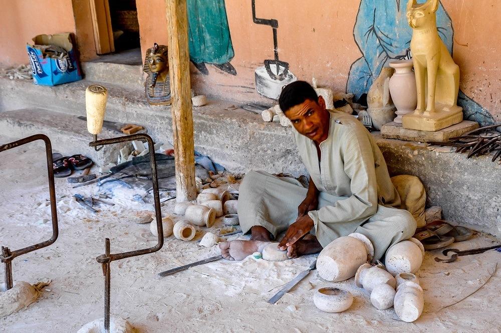 Workman carving alabaster items