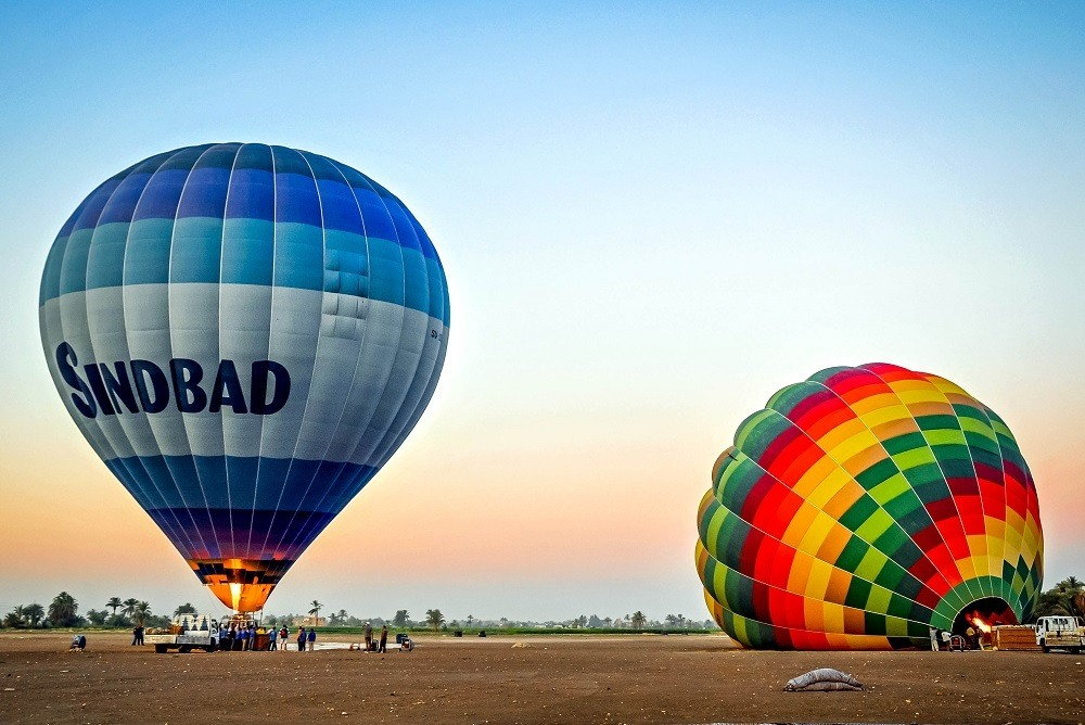 Hot air balloons on the ground being inflated