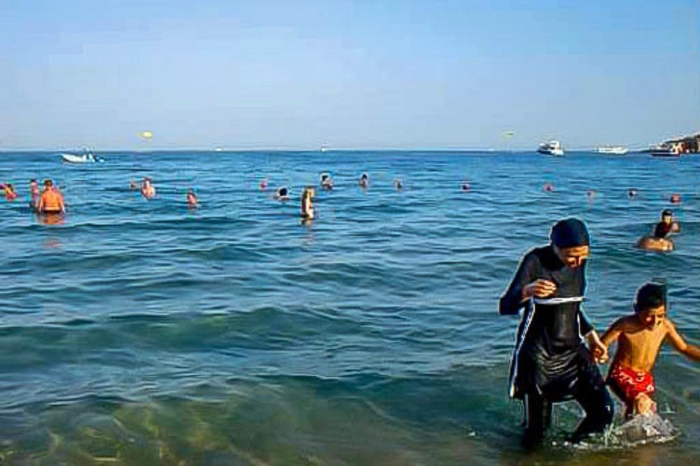 Family swimming in the Red Sea in Sharm el Sheikh Egypt
