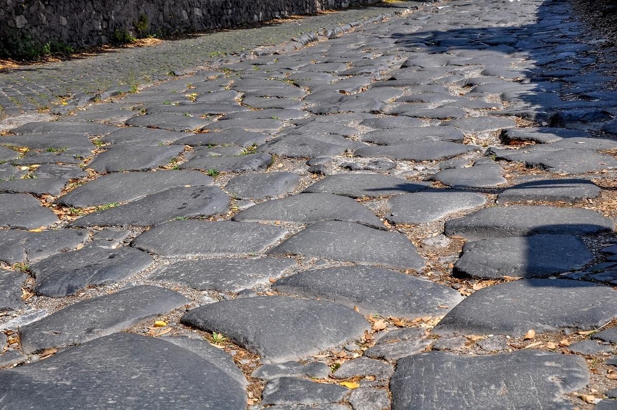 The rough cobblestones of the Appian Way Rome