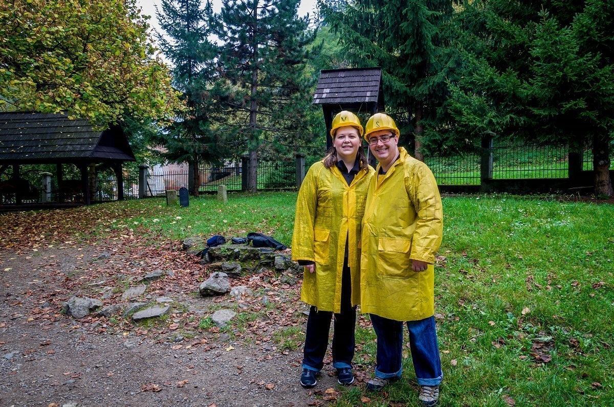 Two people wearing helmets and yellow coats