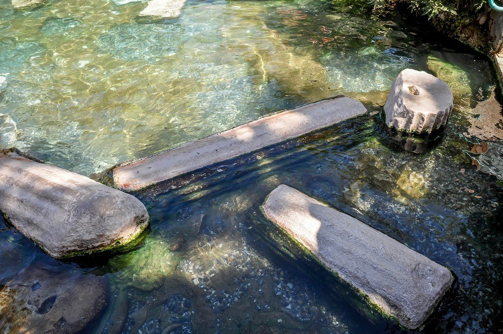 Ancient columns in Cleopatra's pool at the Pamukkale Turkey hot springs