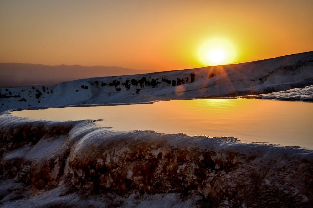Sun setting over the travertine terraces