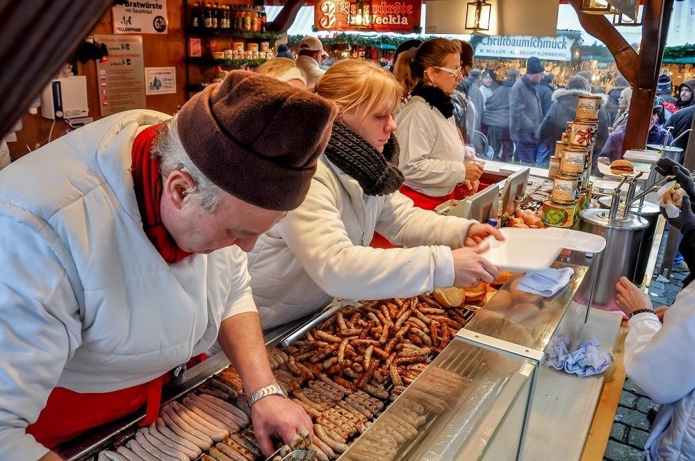 People serving sausages