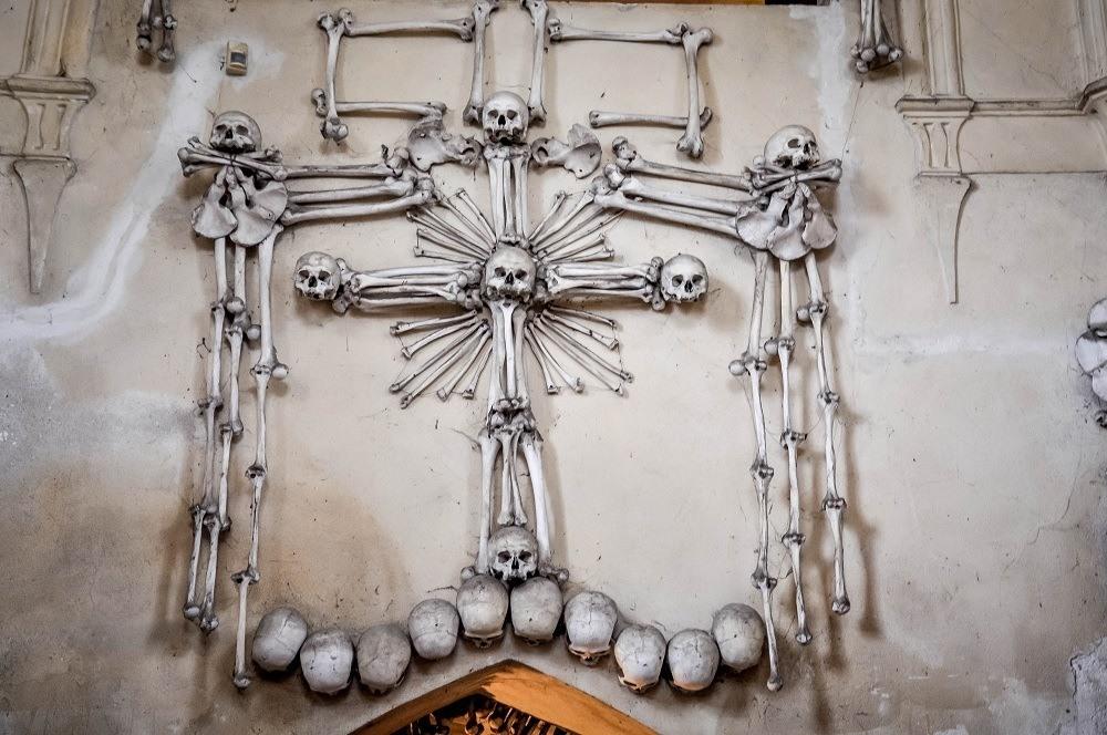 Cross sculpture made of human bones