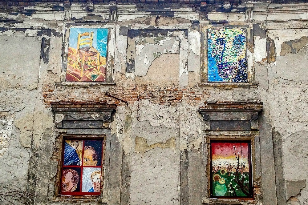 Van Gogh replica paintings on the side of a building while exploring Bratislava in a day