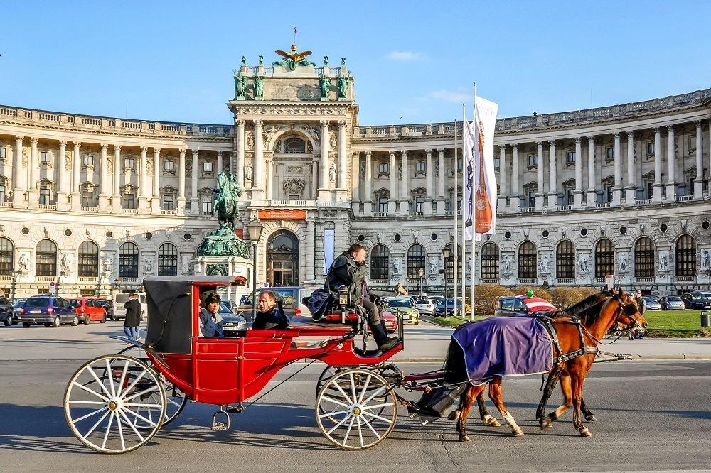 Horse-drawn coach outside the Hofburg Palace in Vienna, Austria