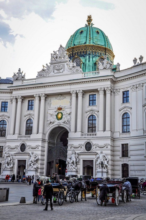 Carriages in front of the Hofburg Palace complex in Vienna, Austria