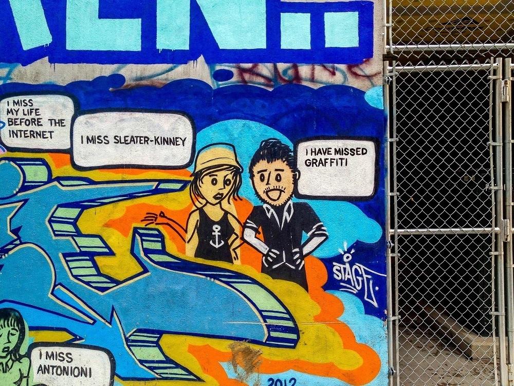 Hipster street art cartoon in the Toronto graffiti alley