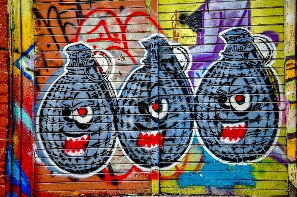 Painting of grenades with faces