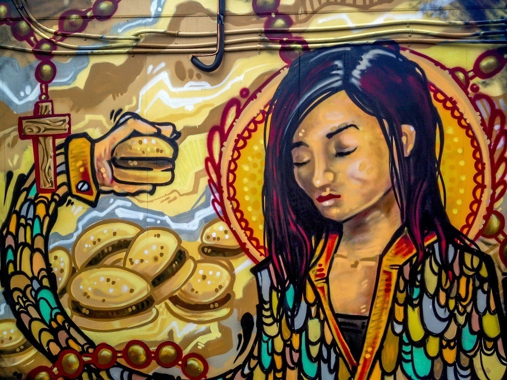 Mural of girl with hamburgers in Graffiti Alley Toronto