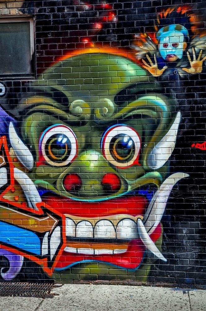 Cartoonish street art in Toronto's Graffiti Alley