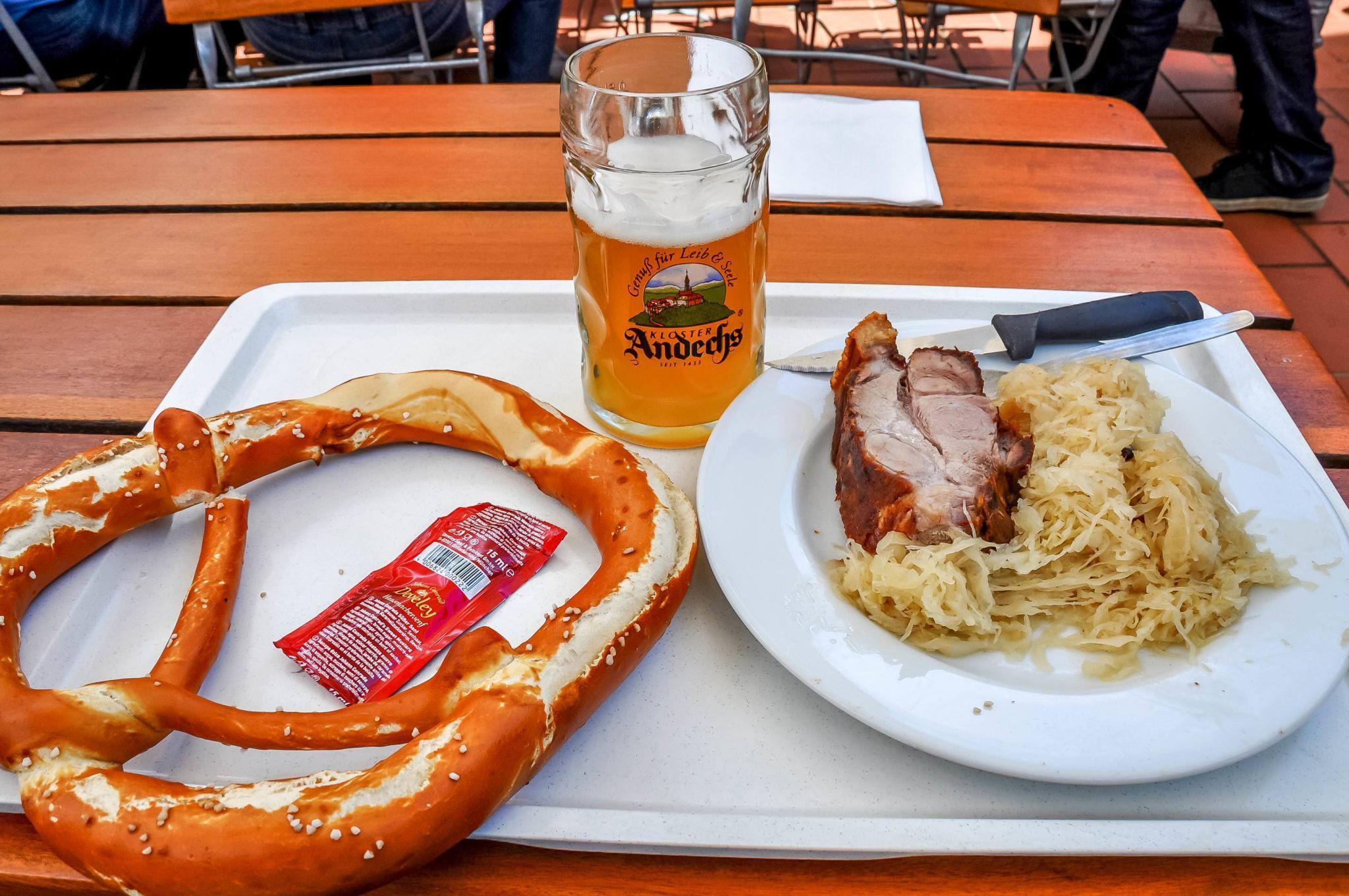 Pretzel, beer, sauerkraut, and pork lunch at Andechs monastery