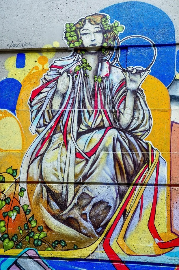 Street mural of woman in a toga
