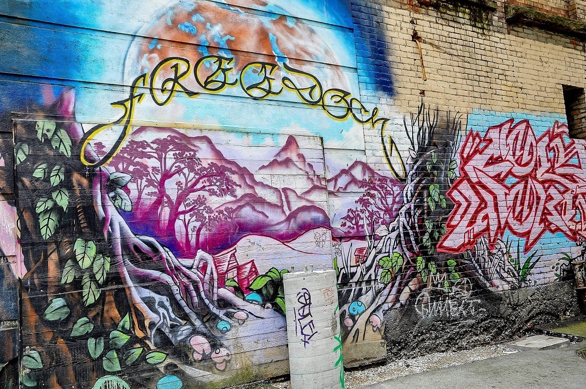 Mural of purple mountains with word  Freedom
