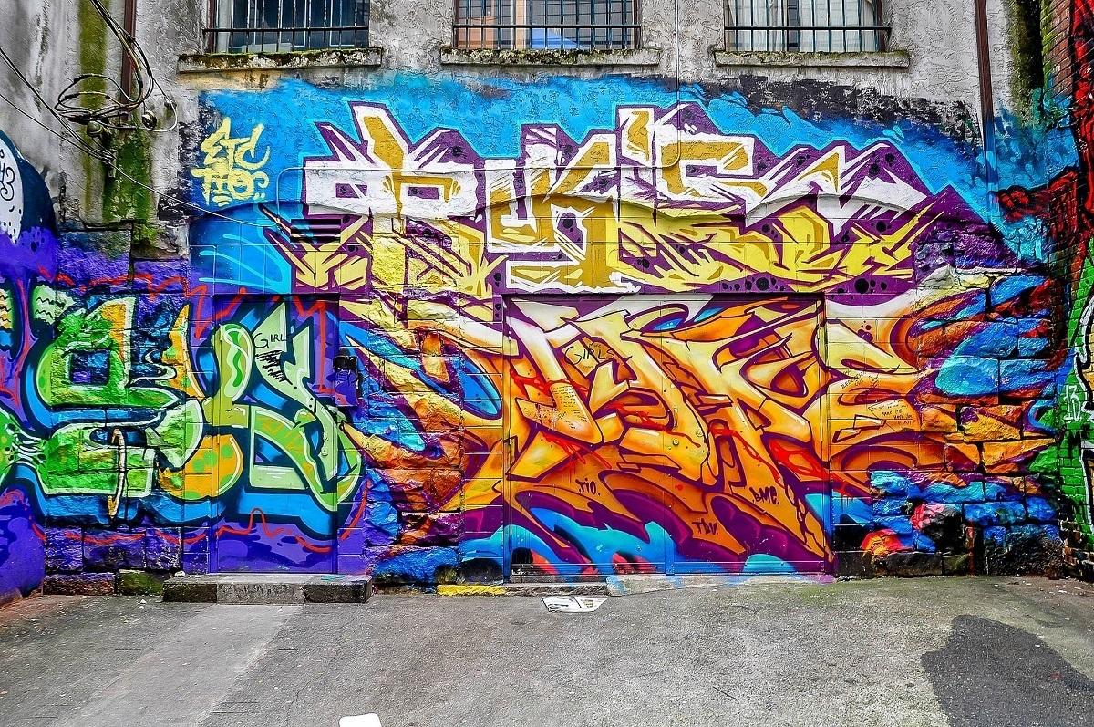 Multi-colored graffiti tag on concrete wall