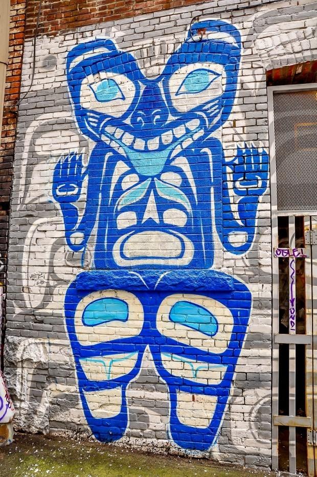 Blue and white Inuit street art mural