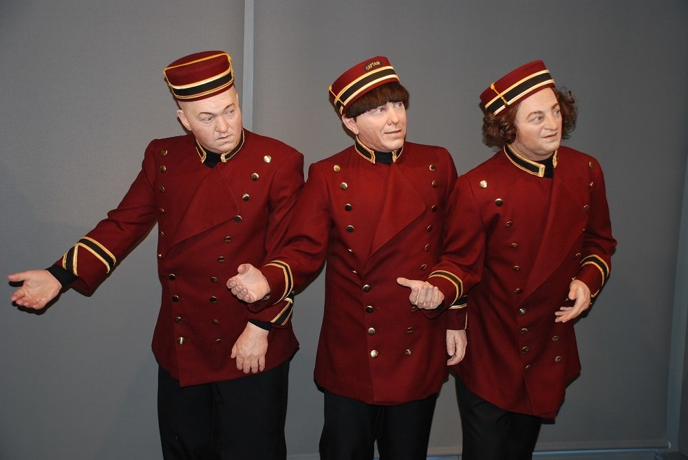 Three Stooges statues in ushers' uniforms at the Stoogeum